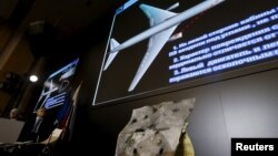 Visuals are displayed during a news conference by Russian arms maker Almaz-Antey at which it presented the results of its probe of last year's downing of Malaysia Airlines flight MH17 over eastern Ukraine, in Moscow, Russia, Oct. 13, 2015.