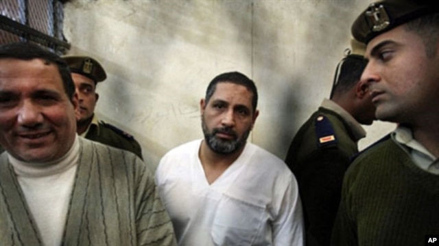 Mohamed Ahmed Hussein aka Mohamed Kammuni, center, along with two other men, has been convicted of killing six Coptic Christians and one policeman, in January 2010 outside a church in the village of Nagaa Hammadi (file photo)