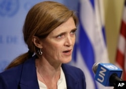 FILE - Samantha Power, U.S. ambassador to the U.N., talks to reporters during a break in Security Council consultations. Power said the resolution 'would break new ground and represent the strongest set of sanctions imposed by the Security Council in more than two decades.'