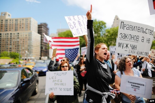 """Demonstrators take part in an anti-Trump """"March for Truth"""" rally at Foley Square on June 3, 2017 in New York City."""