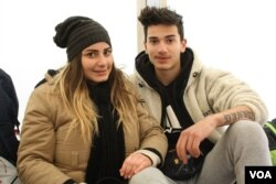 Christina and David Bshara wait in Presevo, Serbia, while traveling to Germany to reunite with their mother, Jan. 19, 2016. (P. Walter Wellman/VOA)