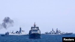 FILE - Chinese and Russian naval vessels are seen during a 2014 joint naval exercise outside Shanghai on the East China Sea.