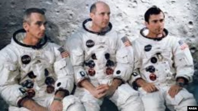 Apollo 10 astronauts Eugene Cernan, Lunar Module Pilot, Thomas Stafford, Commander and John Young, Command Module Pilot are seen in this NASA photograph.