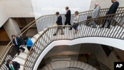 Members of Congress descend to a secure area at the Capitol to meet with national security officials for an intelligence briefing about the decision to swap captive Army Sgt. Bowe Bergdahl for five detainees at Guantanamo Bay, in Washington, June 9, 2014.