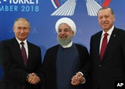 From left, Russian President Vladimir Putin, Iran's President Hassan Rouhani and Turkey's President Recep Tayyip Erdogan are pictured in Tehran, Iran, ahead of their summit to discuss Syria, Sept. 7, 2018.
