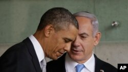 US President Barack Obama, left, listens to Israeli Prime Minister Benjamin Netanyahu during their visit to the Children's Memorial at the Yad Vashem Holocaust memorial in Jerusalem, March 22, 2013.