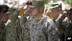 Gen. John Allen, center, the top U.S. commander in Afghanistan, salutes before he observes Memorial Day May 28, 2012.