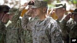 Gen. John Allen, center, the top U.S. commander in Afghanistan, salutes before he observes Memorial Day May 28, 2012.