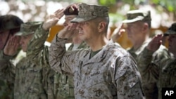 Gen. John Allen, (C), the top U.S. commander in Afghanistan, salutes before he observes Memorial Day at ISAF headquarters in Kabul, Afghanistan, May 28, 2012.