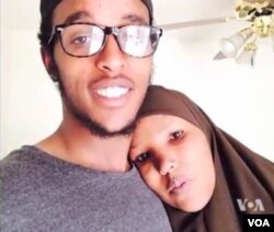 FILE - Abdi Mohamud Nur, shown in this undated photo with his mother, right, is believed to be fighting in Syria.