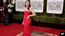 Emmy Rossum arrives at the 73rd annual Golden Globe Awards on Jan. 10, 2016, at the Beverly Hilton Hotel in Beverly Hills, Calif.