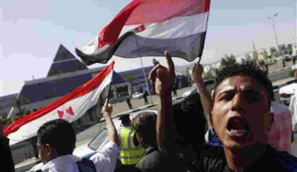 Egyptians shout anti-Mubarak slogans as they demonstrate in front of the hospital where former Egyptian President Hosni Mubarak, 82, is being treated in the Red Sea resort of Sharm el-Sheikh, Egypt, Wednesday, April 13, 2011.