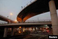 FILE - The Henri Konan Bedie toll bridge, which was named after a former Ivory Coast president, is seen in Abidjan, Dec. 15, 2014.