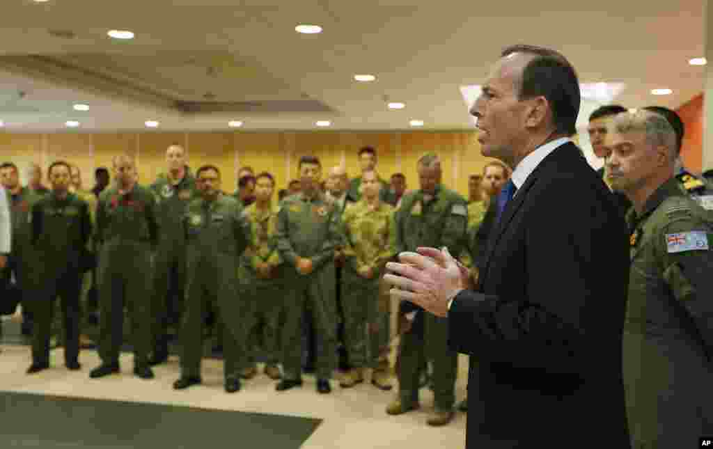 Australian Prime Minister Tony Abbott addresses the international forces currently based in Perth searching for Flight MH370 during his visit to RAAF Base Pearce, March 31, 2014.