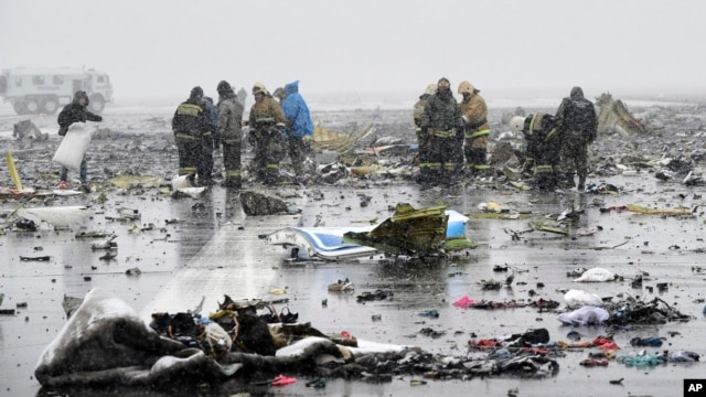Russian Emergency Ministry employees investigate the wreckage of a crashed plane at the Rostov-on-Don airport, about 950 kilometers (600 miles) south of Moscow, March 19, 2016.