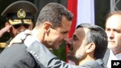 سهرۆکی ئێران مهحمود ئهحمهدینهژاد پـێشـوازی له سهرۆکی سوریا بهشار ئهلئهسهد دهکات له تاران، شهممه 2 ی دهی 2010