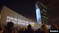 FILE - Messages on methane gas and carbon dioxide emissions are projected onto the United Nations building ahead of the climate change talks that will take place on the sidelines of the U.N. General Assembly, in New York, Sept. 20, 2014.