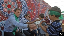 Freed Palestinian prisoner Nael Barghouti (L), who served 33 years in an Israeli jail, more time than any other Palestinian released in a trade for Israeli soldier Gilad Shalit, greets a child along with Fakhri Barghouti (C), who also was released, at Coo