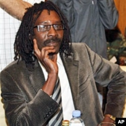 Mahjoub Hussein, secretary general of Sudan Liberation Movement-Revolutionary Forces, attends a meeting with Qatari State Minister for Foreign Affairs Ahmed bin Abdullah al-Mahmud and UN negotiator on Darfur Djibril Bassole in Doha, 25 Jan 2010