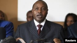 The M23 insurgent rebels' executive secretary Francois Rucogoza speaks during a news conference in Uganda's capital Kampala, January 8, 2013.