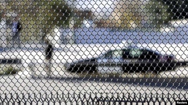 A patrol car is seen through a fence on the US-Mexican border in El Paso, Texas (file photo).