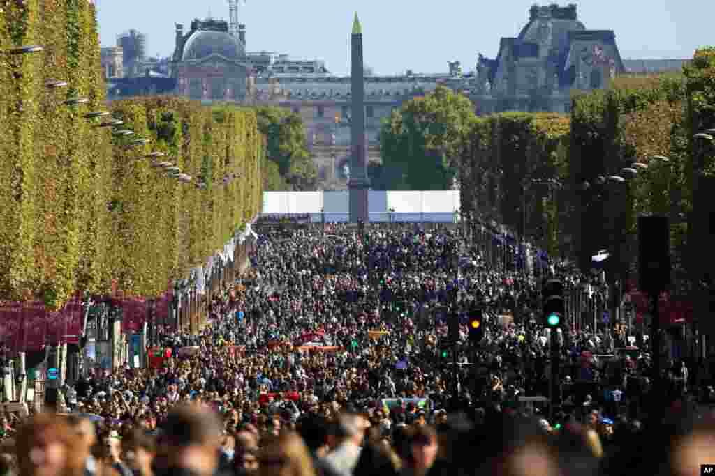 "People walk on the Champs Elysees during the ""day without cars"", in Paris, France."