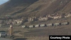 Chinese military trucks outside the Tarmo Monastery in Driru County, Tibetan Autonomous Region