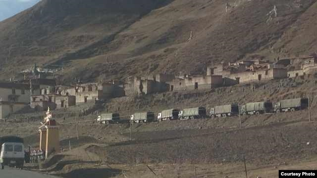 Chinese military trucks outside the Tarmo Monastery in Driru County, Tibetan Autonomous Region