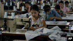 Workers at a garment in Burma.