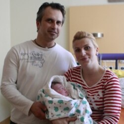 Eileen Goede and Tibor Tary hold their newborn baby Timeo, born at a Berlin hospital at 11:11 am on 1/1/11