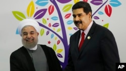 Hassan Rouhani et Nicolas Maduro,17è sommet du mouvement des pays Non-Alignés, 17 septembre 2016. (AP Photo/Ariana Cubillos)