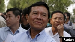 FILE - Kem Sokha, leader of the Cambodia National Rescue Party, arrives to visit fellow party members at the Prey Sar prison on the outskirts of Phnom Penh, Feb. 11, 2016.