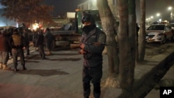 Afghan security forces stand guard near a terrorist attack site, close to the Spanish embassy, in center of Kabul, Afghanistan, Dec. 11, 2015.