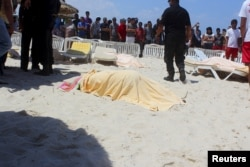 The body of a tourist shot dead by a gunman lies near a beachside hotel in Sousse, Tunisia, June 26, 2015.
