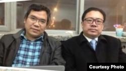 王誓华(左)、周泽(右)在北新桥派出所彻夜声援李建军(微博图片/李蒙不蒙你)