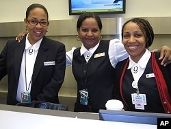 Employees working behind the American Airlines counter were surprised to arrive at 4:00 am to find hundreds already lined up to check in, 19 Feb. 2010