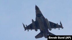A missile-loaded Turkish Air Force warplane rises in the sky after taking off from Incirlik Air Base, in Adana, Turkey, Wednesday, July 29, 2015.