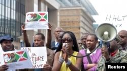 FILE - Singer Khadja Nin (C) takes part in a protest against Burundi President Pierre Nkurunziza and his bid for a third term, in Brussels, Belgium, May 23, 2015.
