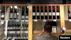 FILE - Bottles of Penfolds Grange, made by Australian wine maker Penfolds and owned by Australia's Treasury Wine Estates.