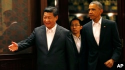 中国国家主席习近平(左)在北京中南海接待到访的美国总统奥巴马(2014年11月11日)