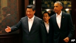 Chinese President Xi Jinping and U.S. President Barack at APEC gatheringTuesday in Beijing.