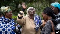 Mary Italo, center, grieves with other relatives for her son Thomas Abayo Italo, 33, who was killed in the Westgate Mall attack, as they wait to receive his body at the mortuary in Nairobi, Kenya Wednesday, Sept. 25, 2013.