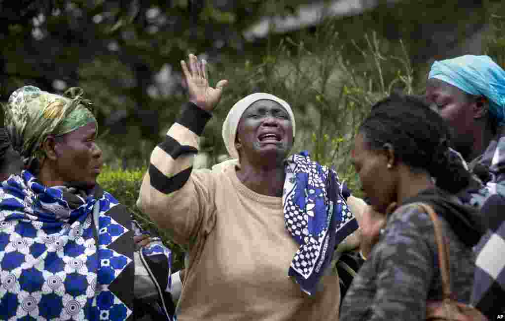 Mary Italo, center, grieves with other relatives for her son Thomas Abayo Italo, 33, who was killed in the Westgate Mall attack, as they wait to receive his body at the mortuary in Nairobi, Kenya, Sept. 25, 2013.