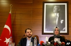 Fatma Betul Sayan Kaya, Turkey's Minister of Family Affairs, and Berat Albayrak, Energy Minister and son-in-law of President Erdogan, speak to the media at Ataturk Airport after her return to Turkey, in Istanbul, March 12, 2017.