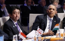 FILE - Japanese Prime Minister Shinzo Abe and President Barack Obama attend the opening session of the Nuclear Security Summit in The Hague, March 24, 2014.