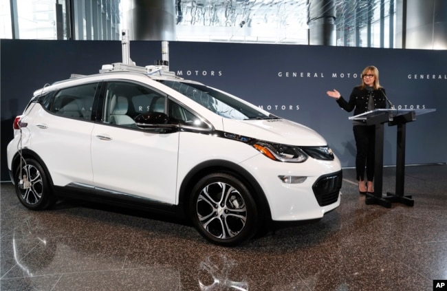 FILE - In this Thursday, Dec. 15, 2016, file photo, General Motors Chairman and CEO Mary Barra speaks next to a autonomous Chevrolet Bolt electric car, in Detroit.