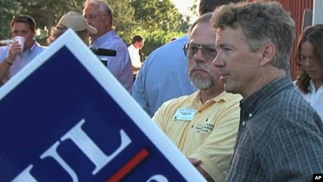Tea Party candidate Rand Paul talks to attendees of the 'Red, White and Blue Picnic' in Owensboro, Kentucky