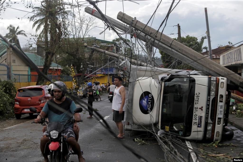Residents are seen after Typhoon Kammuri hit Camalig town, Philippines.