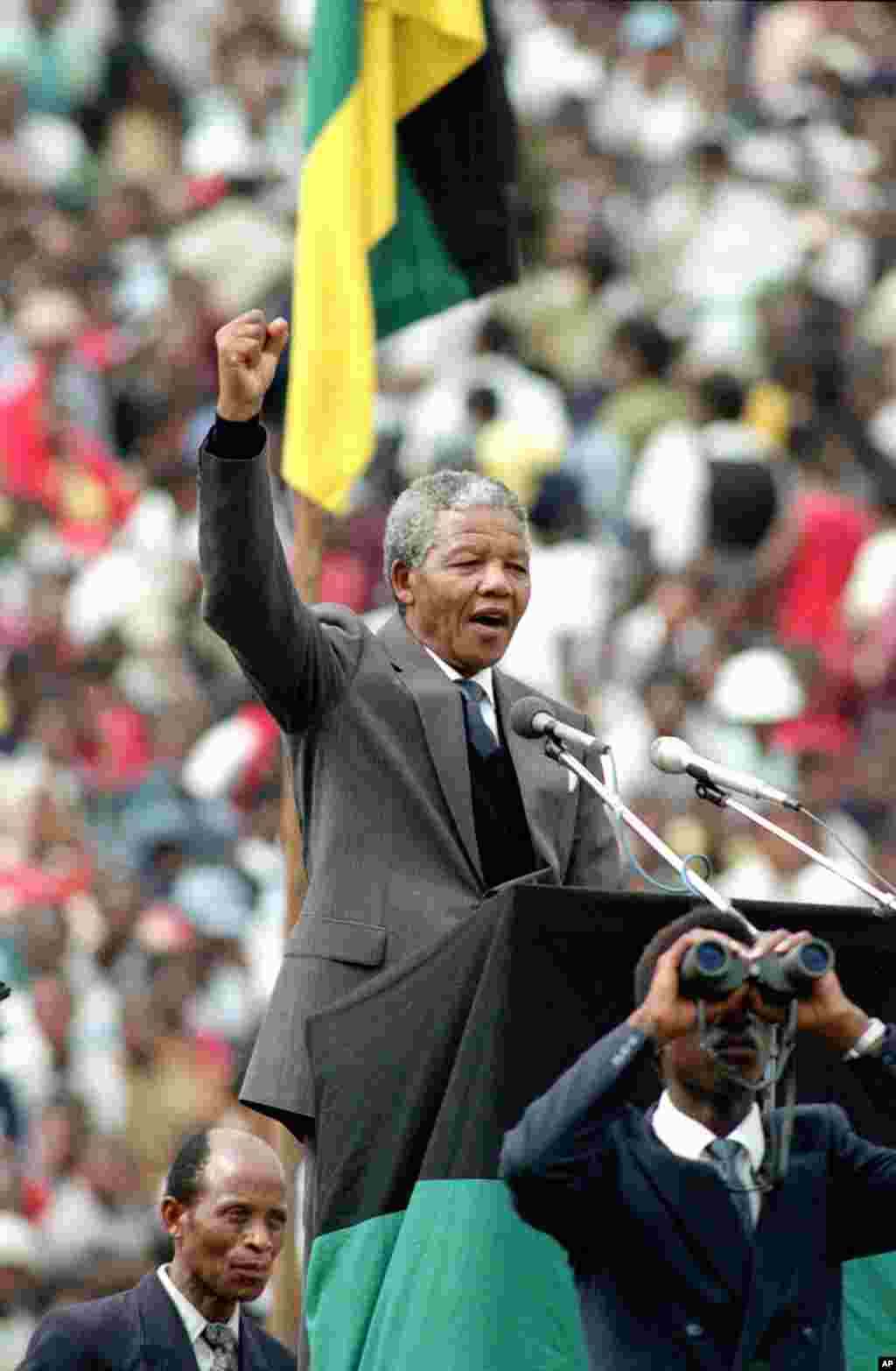 Nelson Mandela, is seen as he gives the black power salute to 120,000 ANC supporters in Soweto's Soccer City stadium, Feb. 13, 1990.