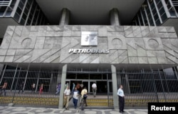 FILE - People enter the headquarters building of Brazilian state oil company Petrobras in Rio de Janeiro.